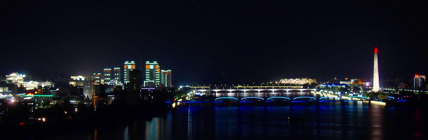 The Pyongyang skyline at night from the Yanggakdo Hotel. This is about as good as the skyline gets. Not always as bright as this.